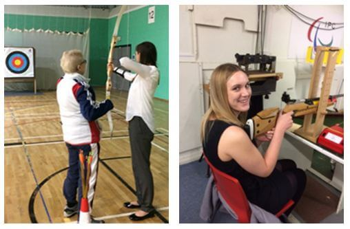Stewarts paralegals trying archery and shooting at Wheelpower Games