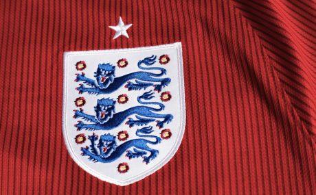 England Football badge on red shirt