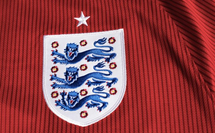England Football badge on red shirt