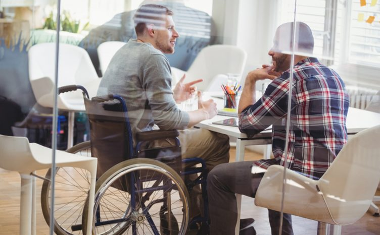 Wheelchair user office meeting
