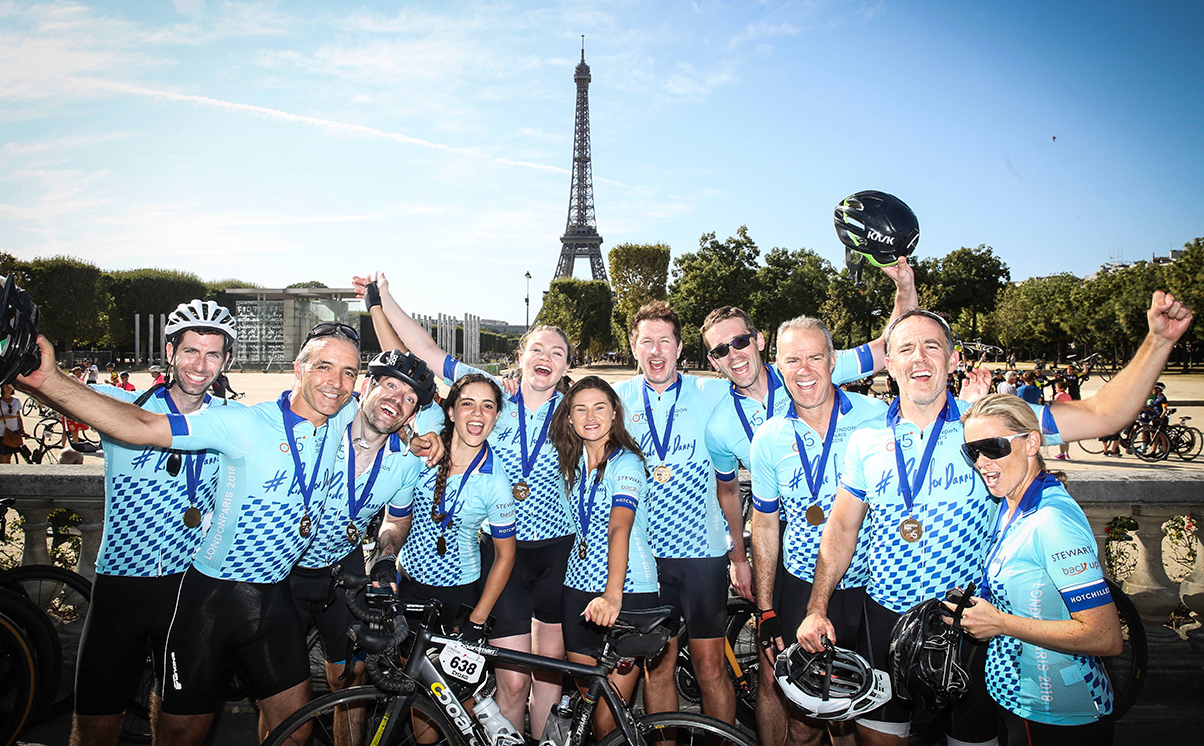 Some of #ridefordanny team in front of Eiffel Tower