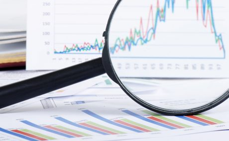 magnifying glass over graphs