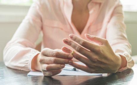 Divorce - Woman taking off wedding ring
