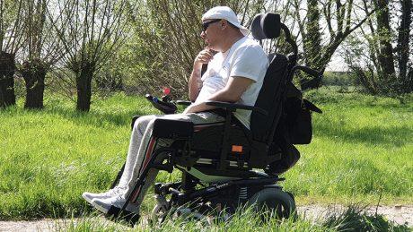 Robert in his powered wheelchair